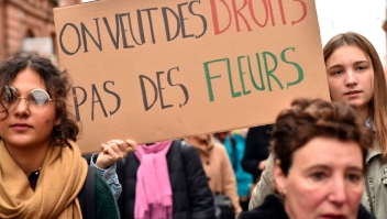 "A woman carries a sign reading ""We want rights, not flowers"" during a demonstration march on March 8, 2017 in Toulouse, as part of International Women's Day. / AFP PHOTO / REMY GABALDA (Photo credit should read REMY GABALDA/AFP/Getty Images)"