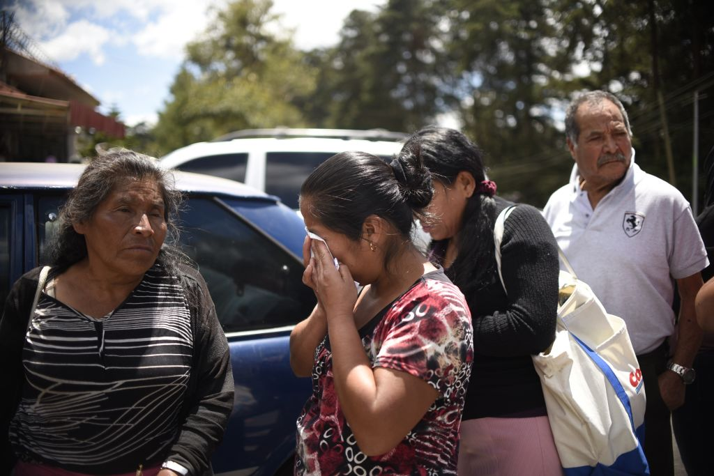 Relatives cry outside the children's shelter Virgen de la Asuncion after a fire at the facility killed at least 19 people, in San Jose Pinula, about 30km east of Guatemala City, on March 8, 2017. At least 19 people died in a fire at a children's shelter in Guatemala, a spokesman for the local fire service said. It was not immediately known how many of the bodies were those of children. The center, supervised by state social welfare authorities, hosts minors who are victims of family mistreatment. The facility has been the target of multiple complaints alleging abuse, and several children have run away. / AFP PHOTO / JOHAN ORDONEZ (Photo credit should read JOHAN ORDONEZ/AFP/Getty Images)