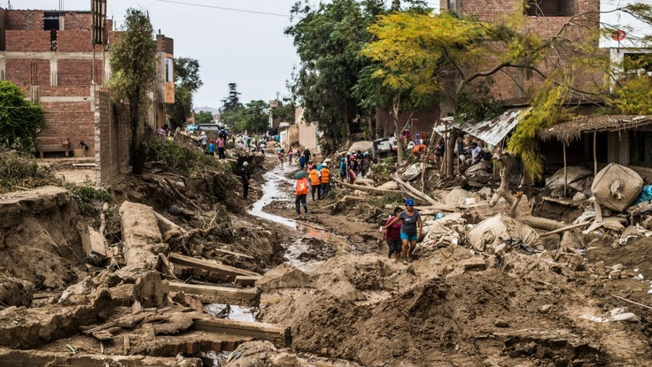 TOPSHOT - A view of the damage caused by flash floods in Huachipa district, east of Lima, on March 19, 2017. El Nino-fuelled flash floods and landslides hit parts of Lima, where most of the water distribution systems have collapsed due to unusual heavy seasonal downpours and people are facing drinking water shortages. / AFP PHOTO / Ernesto BENAVIDES (Photo credit should read ERNESTO BENAVIDES/AFP/Getty Images)