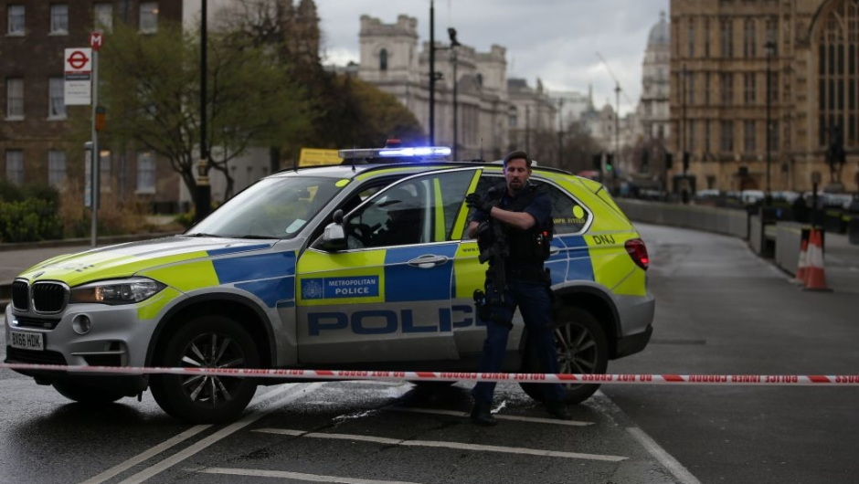 An armed police officer gets out of a car inside a police cordon outside the Houses of Parliament in central London on March 22, 2017 during an emergency incident. / AFP PHOTO / Daniel LEAL-OLIVAS (Photo credit should read DANIEL LEAL-OLIVAS/AFP/Getty Images)