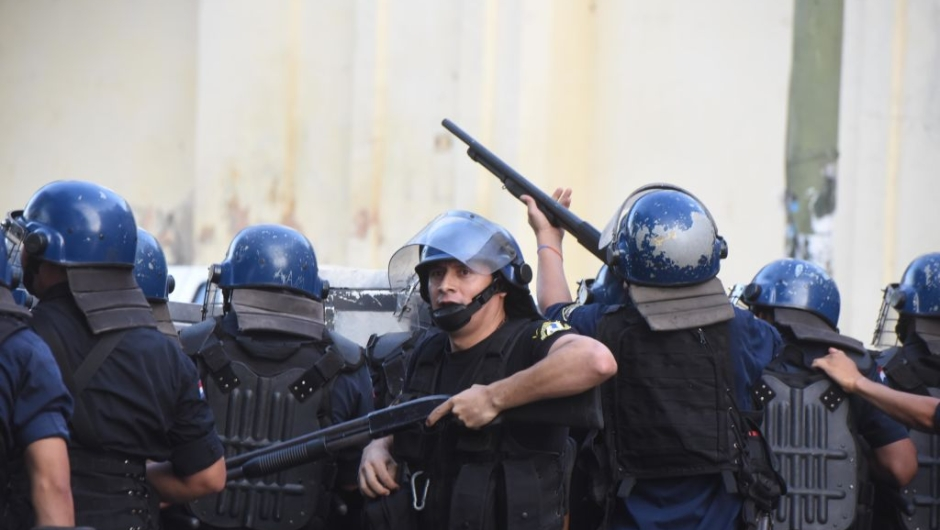 "Riot police agents crack down on a protest against the approval of a constitutional amendment for presidential reelection, outside Congress in Asuncion, on March 31, 2017. Ruling Colorado party senators and their allies, in a so-called ""parallel Senate"", unexpectedly approved an amendment Friday that would allow President Horacio Cartes to run for reelection in 2018, triggering protests that led to clashes between opposition demonstrators and the police. / AFP PHOTO / NORBERTO DUARTE (Photo credit should read NORBERTO DUARTE/AFP/Getty Images)"