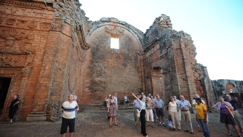 Tourists visit the Jesuitical ruins in Trinidad, Paraguay, on January 27, 2013. The finding of hexagonal tiles from the floor of a large Jesuitical temple built by Guarani indians in the XVII century, rekindled an ambicious project of rediscovering the ruins of the paradise lost when the Jesuits were expelled from the country in 1767. AFP PHOTO/NORBERTO DUARTE (Photo credit should read NORBERTO DUARTE/AFP/Getty Images)
