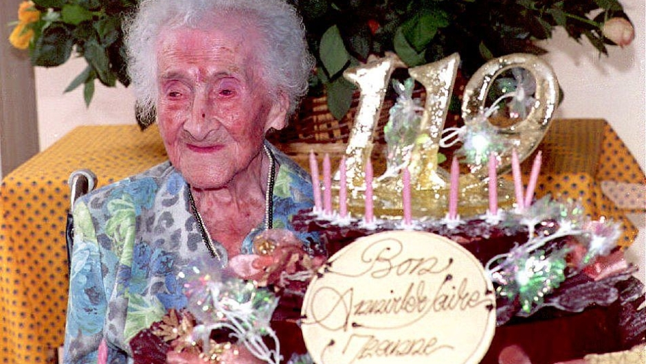 Jeanne Calment, the world's oldest woman according to the Guinness Book of Records for the past three years, celebrates her 119th birthday 21 February 1994 in France. Calment, who weighs only 99 pounds, has been confined to a wheelchair in a nursing home since a hip operation in 1990. (Photo credit should read ERIC CABANIS/AFP/Getty Images)