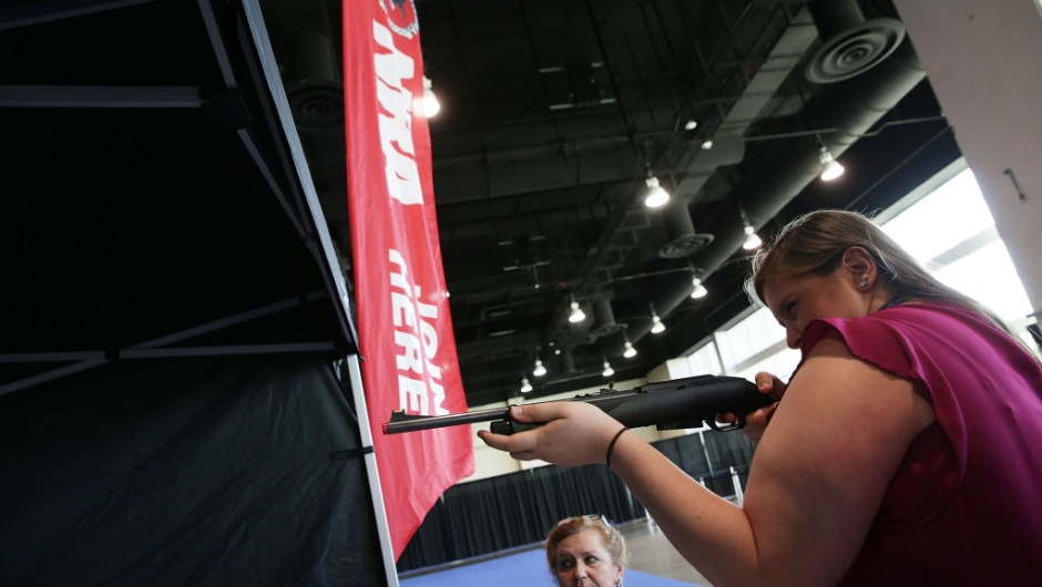 NATIONAL HARBOR, MD - FEBRUARY 23: Allie Vaccaro (R) of Elizabethtown, Pennsylvania, participates in a laser gun target practice at the NRA booth during the Conservative Political Action Conference at the Gaylord National Resort and Convention Center February 23, 2017 in National Harbor, Maryland. Hosted by the American Conservative Union, CPAC is an annual gathering of conservative politicians, commentators and their supporters. (Photo by Alex Wong/Getty Images)