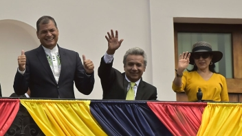 Ecuador's President Rafael Correa (L), President-elect Lenin Moreno (C) and his wife Rocio Gonzalez wave to supporters from the balcony of the Carondelet presidential palace, in Quito on April 3, 2017. Socialist Lenin Moreno on Monday celebrated victory in his bid to extend a decade of leftist rule in Ecuador but faced allegations of voting fraud from his conservative rival. Victory for the 64-year-old Moreno, a wheelchair user and political champion of disability rights, would be good news for the Latin American left, which is in decline. / AFP PHOTO / RODRIGO BUENDIA (Photo credit should read RODRIGO BUENDIA/AFP/Getty Images)