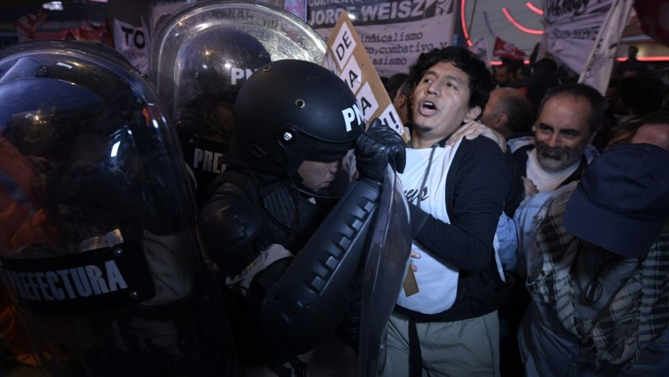 eachers clash with members of Prefectura Naval Argentina who guard the entrance of Pueyrredon bridge in Avellaneda, Buenos Aires on April 6, 2017, during a 24 hours general strike. A 24 hours general strike was called by worker's unions demanding to President Mauricio Macri's government to take measures against inflation and keep campaign promises. / AFP PHOTO / JUAN MABROMATA (Photo credit should read JUAN MABROMATA/AFP/Getty Images)