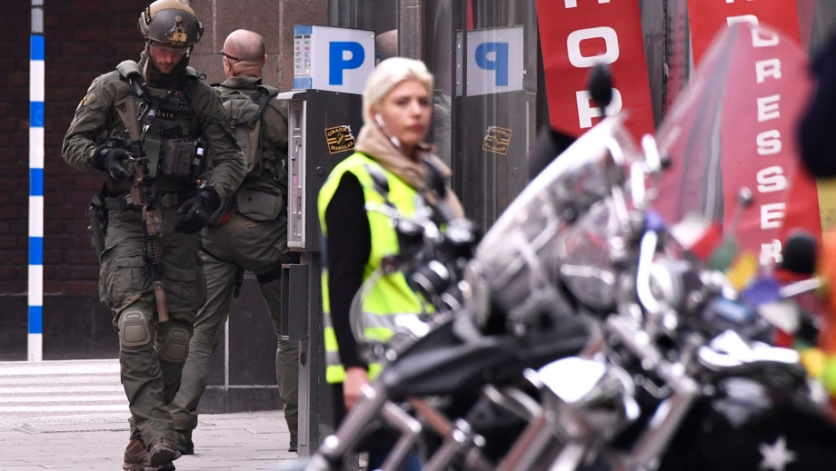 Armed police forces work at the scene where a truck crashed into the Ahlens department store at Drottninggatan in central Stockholm, April 7, 2017. / AFP PHOTO / Jonathan NACKSTRAND / ALTERNATIVE CROP (Photo credit should read JONATHAN NACKSTRAND/AFP/Getty Images)