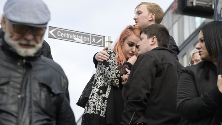 People react at the scene where a truck crashed into the Ahlens department store at Drottninggatan in central Stockholm, April 7, 2017. / AFP PHOTO / TT News Agency / Anders WIKLUND / Sweden OUT (Photo credit should read ANDERS WIKLUND/AFP/Getty Images)