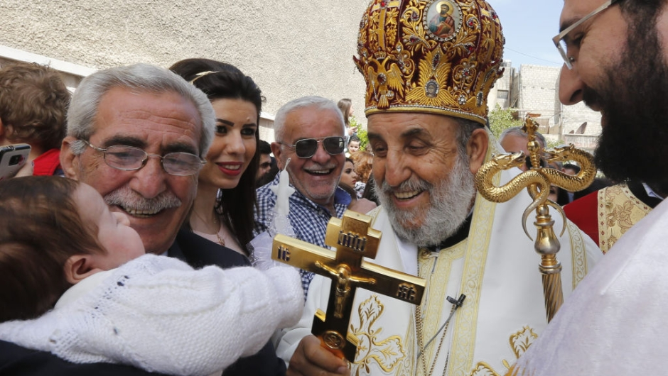 Syrian Christian Orthodox Bishop Moussa attends a parade marking Palm Sunday at the Church of Saint Elias in the Syrian capital Damascus on April 9, 2017. Palm Sunday is the final Sunday of Lent, the beginning of the Holy Week, and commemorates the triumphant arrival of Jesus Christ in Jerusalem, days before he was crucified. / AFP PHOTO / Louai Beshara (Photo credit should read LOUAI BESHARA/AFP/Getty Images)