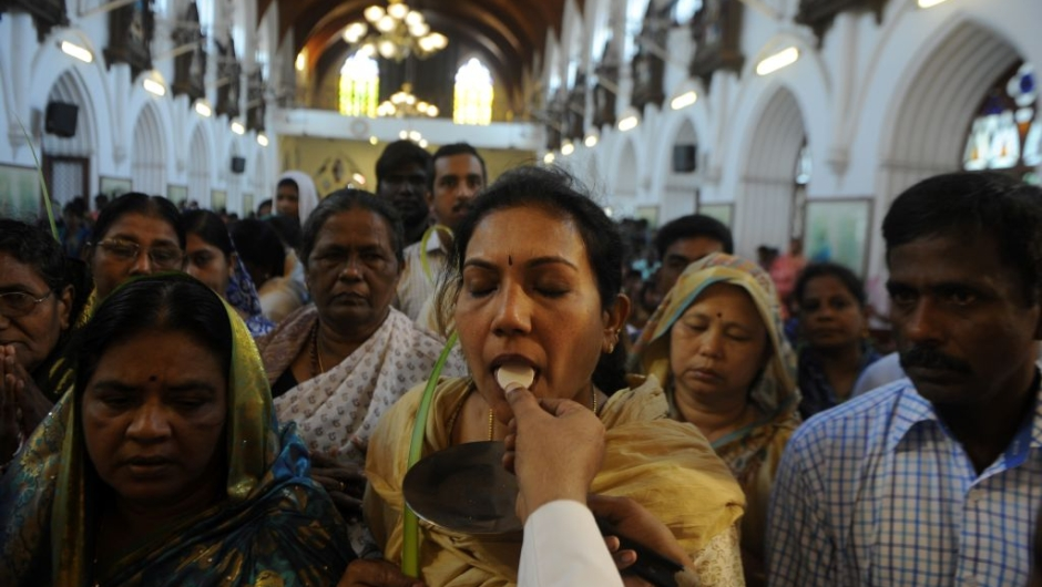 A Indian Christian worshippers receives Holy Communion during Palm Sunday Mass in Chennai on April 9, 2017. Palm Sunday marks the sixth and last Sunday of Lent and the beginning of Holy Week. / AFP PHOTO / ARUN SANKAR (Photo credit should read ARUN SANKAR/AFP/Getty Images)