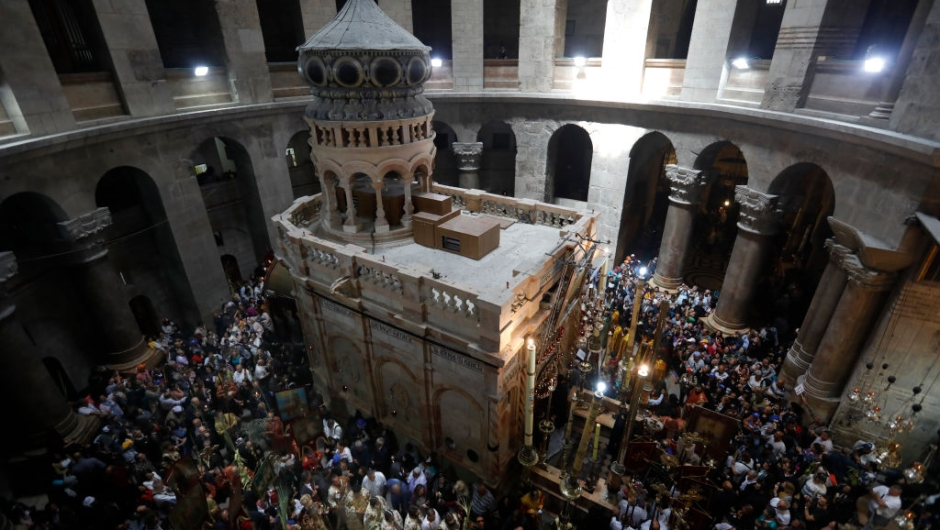 Christian Orthodox communities attend the Palm Sunday Easter procession at the Church of the Holy Sepulchre in Jerusalem's Old City on April 9, 2017. The ceremony is a landmark in the Roman Catholic calendar, marking the triumphant return of Christ to Jerusalem the week before his death, when a cheering crowd greeted him waving palm leaves. Palm Sunday marks the start of the most solemn week in the Christian calendar. / AFP PHOTO / GALI TIBBON (Photo credit should read GALI TIBBON/AFP/Getty Images)