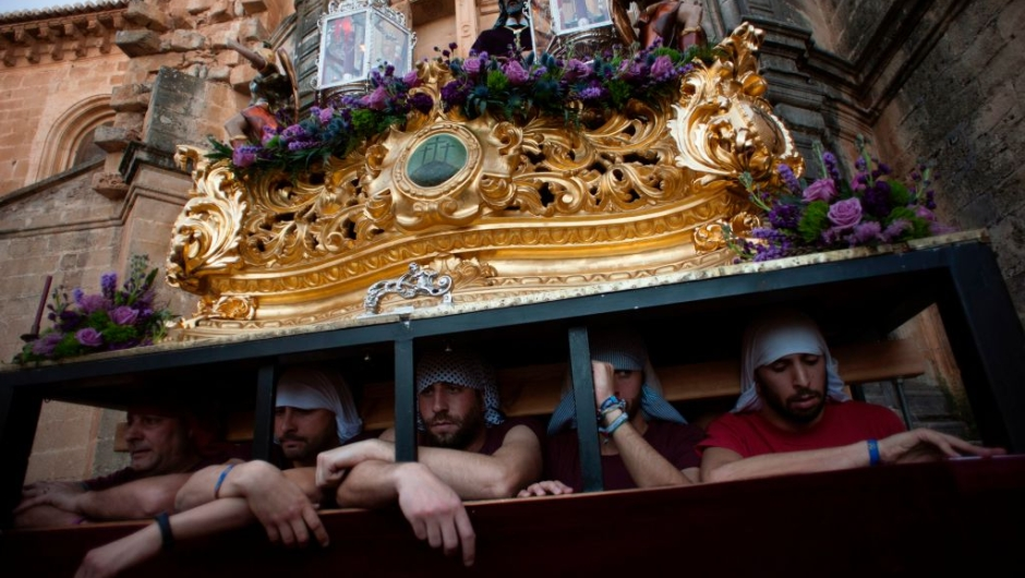 """Penitents wait to carry a statue of the """"Cristo de los Gitanos"""" (Christ of the Gypsies) during the """"Gitanos"""" (The Gypsy) brotherhood procession on April 9, 2017 in Ronda, during the Holy Week. Christian believers around the world mark the Holy Week of Easter in celebration of the crucifixion and resurrection of Jesus Christ. / AFP PHOTO / JORGE GUERRERO (Photo credit should read JORGE GUERRERO/AFP/Getty Images)"""