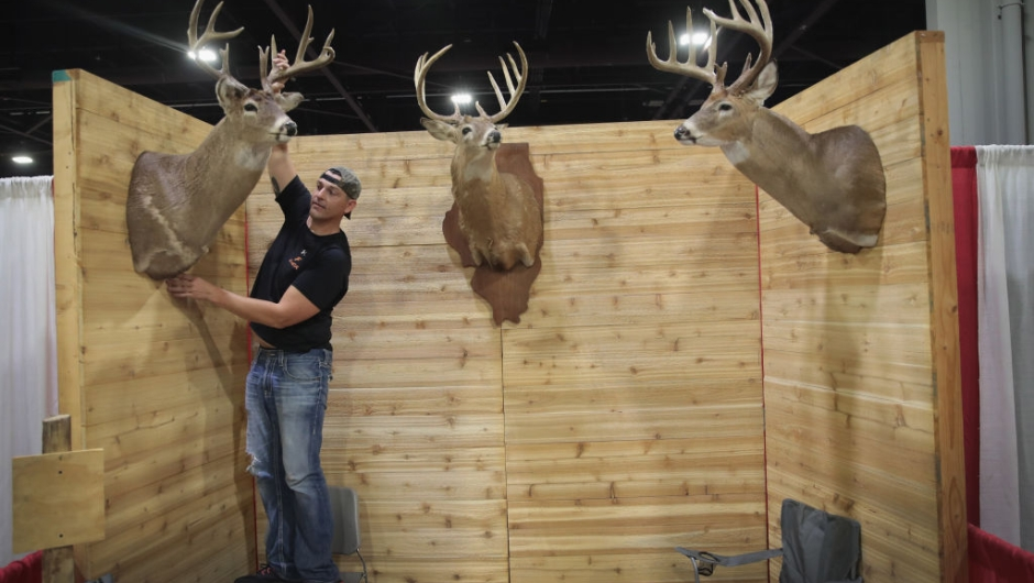 ATLANTA, GA - APRIL 27: Aaron Quillan, a hunting outfitter, sets up his Monarch Rivers booth before the start of the 146th NRA Annual Meetings & Exhibits on April 27, 2017 in Atlanta, Georgia. The event begins tomorrow and runs through April 30. President Donald Trump is scheduled to speak at the NRA-ILA's annual Leadership Forum at the event tomorrow. (Photo by Scott Olson/Getty Images)
