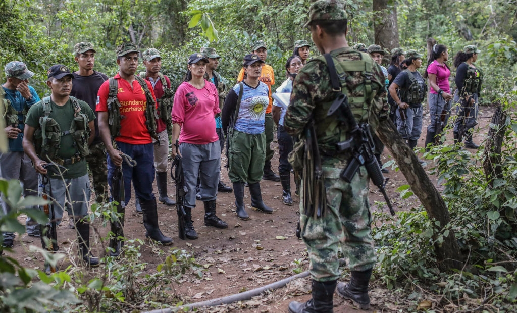 "FARC guerrillas fall in during a review at their camp in the Transitional Standardization Zone in Pondores, La Guajira department, Colombia on April 3, 2017. The Colombian government reported that the FARC guerrillas provided a total list with the names of the 6,084 members of the rebel group who have gathered in 26 ""standardization zones"" across the country, where they are building accomodations that will house them until the end of the disarmament process, outlined in the peace agreement reached in November 2016. / AFP PHOTO / Joaquin Sarmiento (Photo credit should read JOAQUIN SARMIENTO/AFP/Getty Images)"