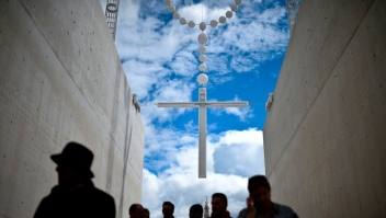 People walk under a giant rosary hanging at Fatima Sanctuary in Fatima, central Portugal, on May 12, 2017. Two of the three child shepherds who reported apparitions of the Virgin Mary in Fatima, Portugal, one century ago, will be declared saints on May 13, 2017 by Pope Francis. The canonisation of Jacinta and Francisco Marto will take place during the Argentinian pontiff's visit to a Catholic shrine visited by millions of pilgrims every year. / AFP PHOTO / PATRICIA DE MELO MOREIRA (Photo credit should read PATRICIA DE MELO MOREIRA/AFP/Getty Images)