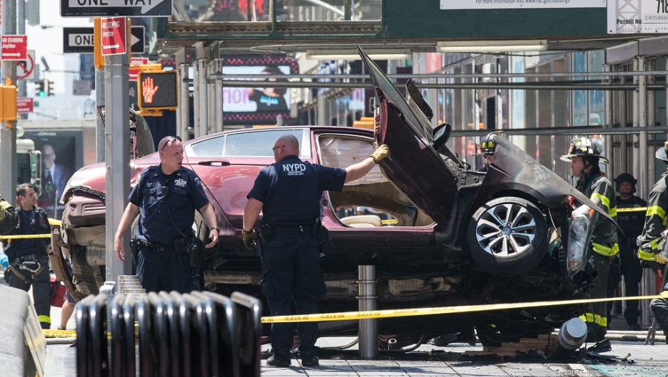 NEW YORK, NY - MAY 18: A wrecked car sits in the intersection of 45th and Broadway in Times Square, May 18, 2017 in New York City. According to reports there were multiple injuries and one fatality after the car plowed into a crowd of people. (Photo by Drew Angerer/Getty Images)