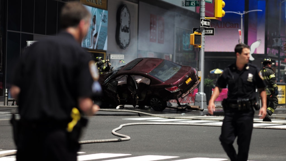 TOPSHOT - Police secure an are near a car after it plunged into pedestrians in Times Square in New York on May 18, 2017. A speeding car struck pedestrians in New York's Times Square on, killing one person and injuring 12 others in an accident in one of Manhattan's most popular tourists spots, officials said. / AFP PHOTO / Jewel SAMAD (Photo credit should read JEWEL SAMAD/AFP/Getty Images)