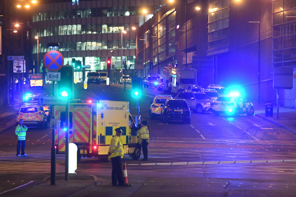 Emergency response vehicles are parked at the scene of a suspected terrorist attack during a pop concert by US star Ariana Grande in Manchester, northwest England on May 23, 2017. / AFP PHOTO / Paul ELLIS (Photo credit should read PAUL ELLIS/AFP/Getty Images)