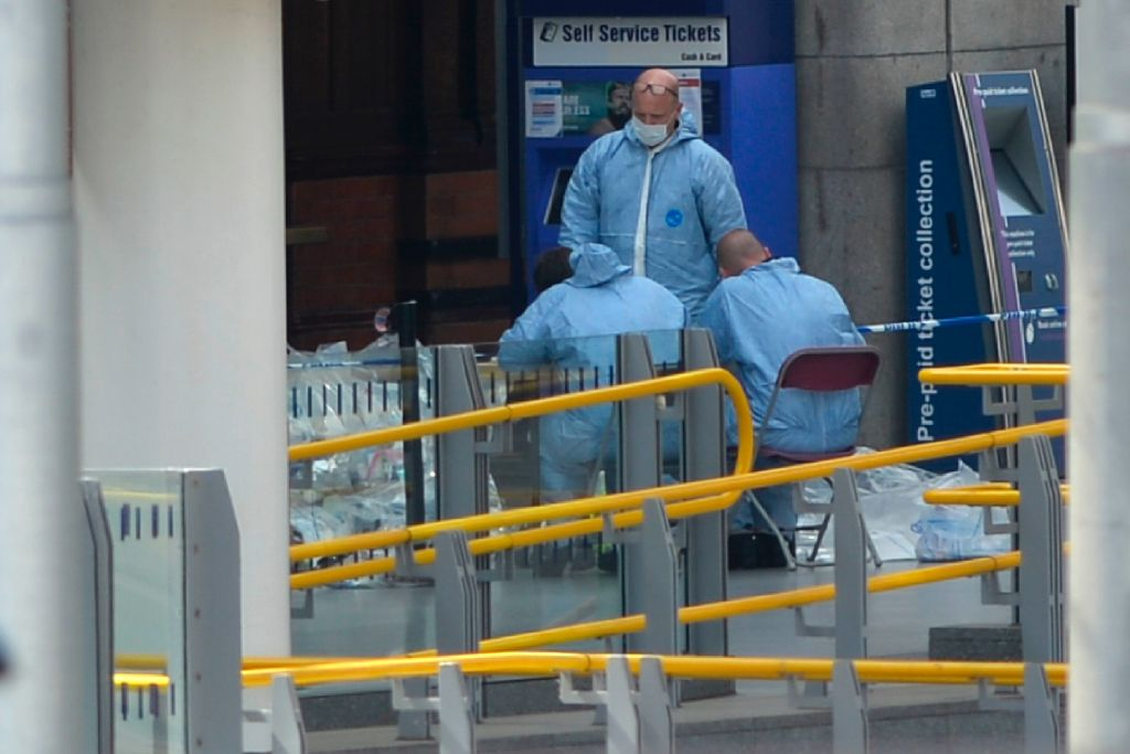TOPSHOT - Forensics officers work at the scene at Manchester Victoria station in central Manchester, northwest England on May 23, 2017 following a deadly terror attack at a concert at the exit of the adjoining Manchester Arena the night before. Twenty two people have been killed and dozens injured in Britain's deadliest terror attack in over a decade after a suspected suicide bomber targeted fans leaving a concert of US singer Ariana Grande in Manchester. / AFP PHOTO / Ben Stansall (Photo credit should read BEN STANSALL/AFP/Getty Images)