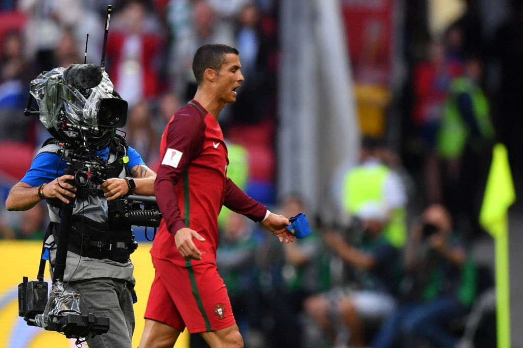 Portugal's forward Cristiano Ronaldo walks off the pitch after the 2017 Confederations Cup group A football match between Portugal and Mexico at the Kazan Arena in Kazan on June 18, 2017. / AFP PHOTO / Yuri CORTEZ (Photo credit should read YURI CORTEZ