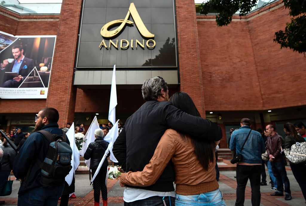 People attend a tribute for the victims a day after three women were killed in a bomb attack at the Andino mall, in Bogota, on June 18, 2017. Colombia's leaders and main rebel groups pledged Sunday that a mall bombing would not disrupt the country's peace process, even as authorities scrambled to find out who was behind the carnage. The victims -- two Colombians and a Frenchwoman -- perished when a device exploded in a ladies' restroom in the crowded Andino shopping centre in Bogota on Saturday. At least nine people were also wounded, officials said. / AFP PHOTO / Raul ARBOLEDA (Photo credit should read RAUL ARBOLEDA/AFP/Getty Images)