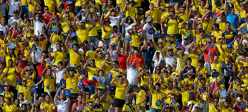 Colombia's fans celebrate James Rodriguez goal against Venezuela during their WC 2018 football qualification match in Barranquilla, Colombia on September 1, 2016. / AFP / LUIS ROBAYO (Photo credit should read LUIS ROBAYO/AFP/Getty Images)
