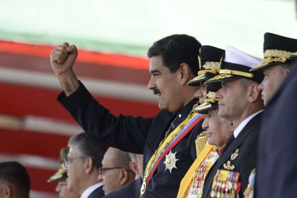 Venezuelan President Nicolas Maduro heads the country's Independence Day celebrations in Caracas on July 5, 2017. Dozens of pro-government activists stormed into the seat of Venezuela's National Assembly Wednesday as the opposition-controlled legislature was holding a special session to mark the independence day. / AFP PHOTO / FEDERICO PARRA (Photo credit should read FEDERICO PARRA/AFP/Getty Images)