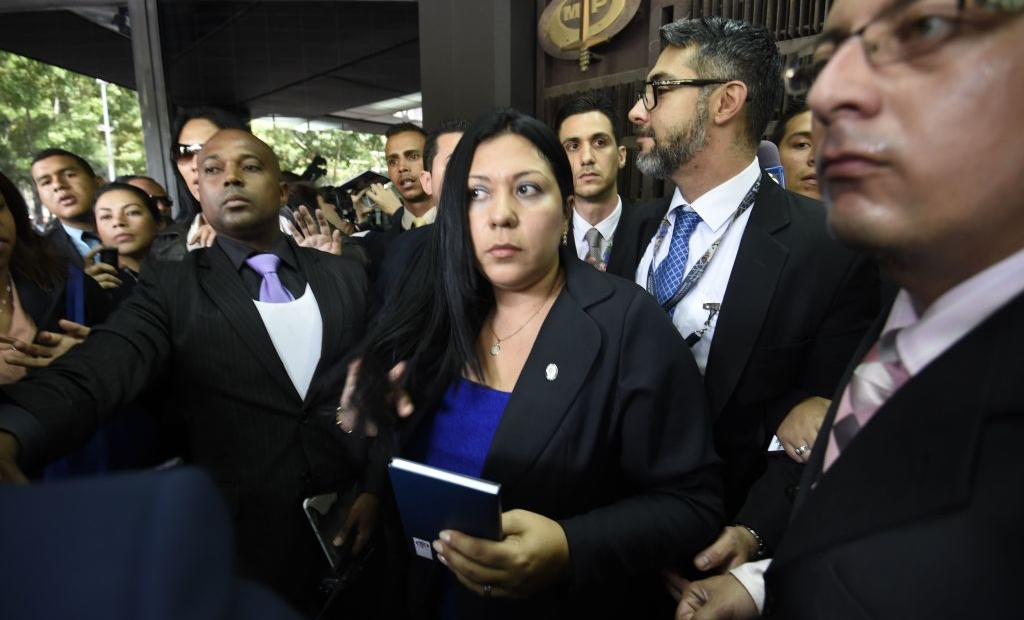 Venezuela's Supreme Court-appointed deputy Attorney General, Katherine Haringhton, is denied entry to the Public Ministry in Caracas on July 6, 2017. A political and economic crisis in the oil-producing country has spawned often violent demonstrations by protesters demanding President Nicolas Maduro's resignation and new elections. The unrest has left 91 people dead since April 1. / AFP PHOTO / Juan BARRETO (Photo credit should read JUAN BARRETO/AFP/Getty Images)