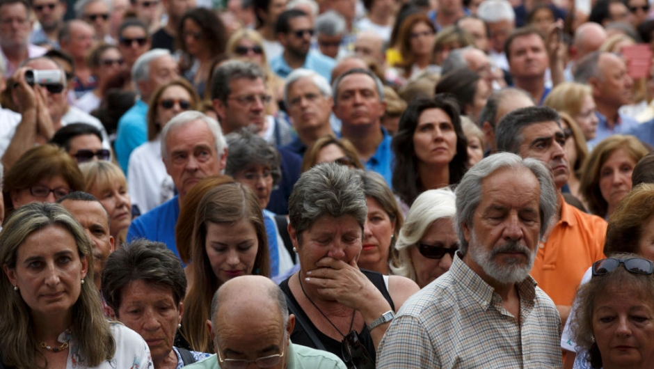 LAS ROZAS, SPAIN - JUNE 08: A woman gets moved as she attend a vigil in tribute to Ignacio Echavarria amid other people outside of Las Rozas City Council on June 8, 2017 in Las Rozas, Madrid province, Spain. Spanish Ignacio Echevarria 39, was confirmed yesterday as one of the 8 victims of London Bridge terror attack. Echevarria is hailed as 'skateboard hero' after he confronted the three terrorists using his skateboard when they were attacking other members of the public with knives near Borough Market in London on June 3. All three terrorists were gunned down by police moments later. (Photo by Pablo Blazquez Dominguez/Getty Images)