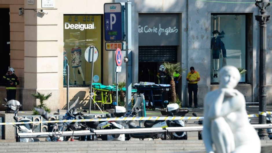 Firefighters stands outside an evacuated mall after a van ploughed into the crowd, injuring several persons on the Rambla in Barcelona on August 17, 2017. / AFP PHOTO / Josep LAGO (Photo credit should read JOSEP LAGO/AFP/Getty Images)