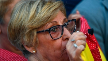 A woman cries as she observes a minute of silence for the victims of the Barcelona attack at Puerta del Sol in Madrid on August 18, 2017, a day after a van ploughed into the crowd, killing 13 persons and injuring over 100 on the Rambla in Barcelona. Drivers have ploughed on August 17, 2017 into pedestrians in two quick-succession, separate attacks in Barcelona and another popular Spanish seaside city, leaving 13 people dead and injuring more than 100 others. In the first incident, which was claimed by the Islamic State group, a white van sped into a street packed full of tourists in central Barcelona on Thursday afternoon, knocking people out of the way and killing 13 in a scene of chaos and horror. Some eight hours later in Cambrils, a city 120 kilometres south of Barcelona, an Audi A3 car rammed into pedestrians, injuring six civilians -- one of them critical -- and a police officer, authorities said. / AFP PHOTO / GABRIEL BOUYS (Photo credit should read GABRIEL BOUYS/AFP/Getty Images)