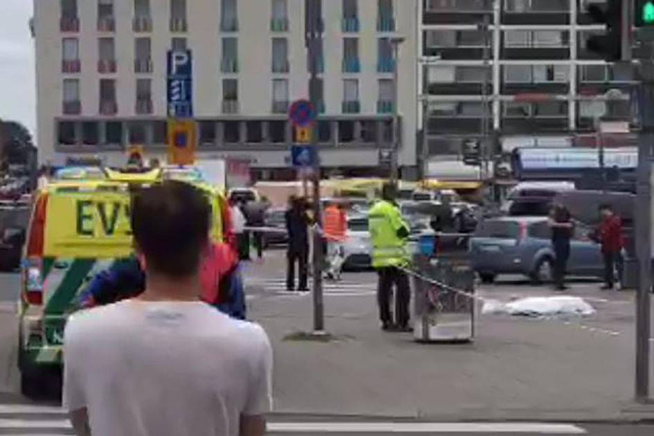 """A video grab taken from Twitter on August 18, 2017 shows officials standing in a street in the Finnish city of Turku where several people were stabbed. """"Police shot the suspected perpetrator in the legs,"""" police wrote on Twitter. """"The person has been arrested. We recommend that people avoid central Turku / AFP PHOTO / Juha Riihimaki (Photo credit should read JUHA RIIHIMAKI/AFP/Getty Images)"""