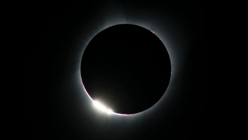 "TOPSHOT - The ""diamond ring effect"" is seen during a total solar eclipse as seen from the Lowell Observatory Solar Eclipse Experience on August 21, 2017 in Madras, Oregon. Millions will be able to witness the total eclipse that will touch land in Oregon on the west coast and continue through South Carolina on the east coast. / AFP PHOTO / STAN HONDA (Photo credit should read STAN HONDA/AFP/Getty Images)"