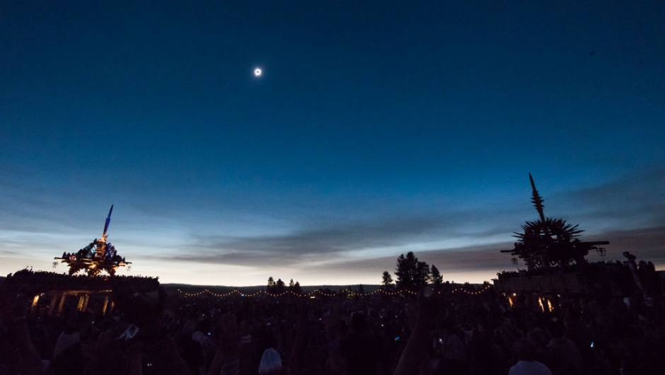 "The sun's corona only is visible during a total solar eclipse between the Solar Temples at Big Summit Prairie ranch in Oregon's Ochoco National Forest near the city of Mitchell August 21, 2017. The Sun started to vanish behind the Moon as the partial phase of the so-called Great American Eclipse began Monday, with millions of eager sky-gazers soon to witness ""totality"" across the nation for the first time in nearly a century. / AFP PHOTO / Robyn Beck (Photo credit should read ROBYN BECK/AFP/Getty Images)"