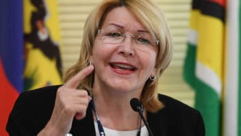 """Venezuela's fugitive former top prosecutor Luisa Ortega, one of President Nicolas Maduro's most vocal critics, speaks, invited by Brazil's prosecutor general Rodrigo Janot, during a conference with representatives from the Latin American regional trading alliance Mercosur, in Brasilia, on August 23, 2017. Ortega promised to use the international forum in Brazil to intensify corruption allegations against Maduro, who called for her arrest. Days after a dramatic escape from Venezuela, Ortega arrived in Brasilia promising to dish dirt on Maduro, who in turn asked Interpol to put out a """"red notice"""" warrant for his critic. / AFP PHOTO / EVARISTO SA (Photo credit should read EVARISTO SA/AFP/Getty Images)"""