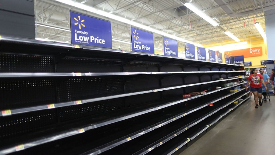 HOUSTON, TX - AUGUST 24: The bread section of a Walmart store is empty as people prepare for the possible arrival of Hurricane Harvey on August 24, 2017 in Houston, Texas. Hurricane Harvey has intensified into a hurricane and is aiming for the Texas coast with the potential for up to 3 feet of rain and 125 mph winds.(Photo by Joe Raedle/Getty Images)