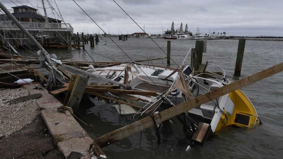 A sunken boat in the marina after Hurricane Harvey hit Port Aransas, Texas on August 27, 2017. Hurricane Harvey hit the Texas coast with forecasters saying its possible for up to three feet of rain and 125 mpg wind. / AFP PHOTO / MARK RALSTON (Photo credit should read MARK RALSTON/AFP/Getty Images)
