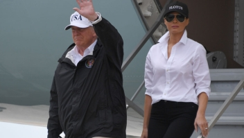 US President Donald Trump and First Lady Melania Trump arrive n Corpus Christi, Texas on August 29, 2017. President Donald Trump flew into storm-ravaged Texas Tuesday in a show of solidarity and leadership in the face of the deadly devastation wrought by Harvey -- as the battered US Gulf Coast braces for even more torrential rain. Four days after Harvey slammed onshore as a monster Category Four hurricane, turning roads to rivers in America's fourth-largest city, emergency crews are still racing to reach hundreds of stranded people in a massive round-the-clock rescue operation. / AFP PHOTO / JIM WATSON (Photo credit should read JIM WATSON/AFP/Getty Images)