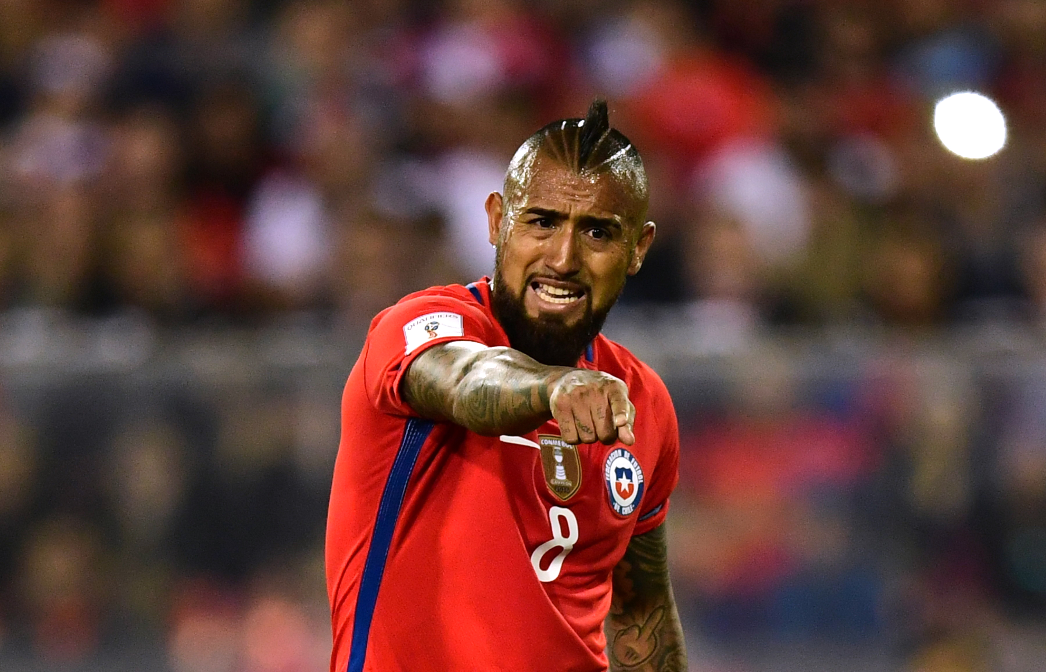 Chile's Arturo Vidal gestures during the 2018 World Cup qualifier football match against Paraguay, in Santiago, on August 31, 2017. / AFP PHOTO / Martin BERNETTI (Photo credit should read MARTIN BERNETTI/AFP/Getty Images)