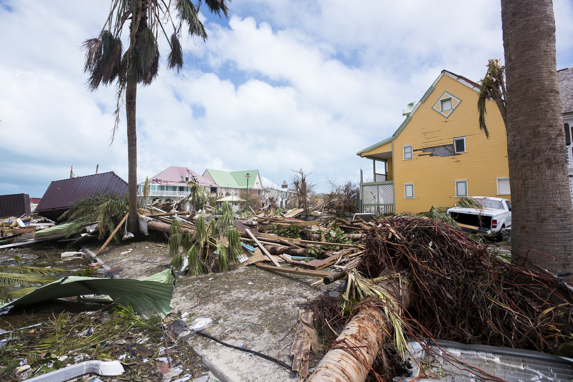 TOPSHOT - A photo taken on September 7, 2017 shows damage in Orient Bay on the French Carribean island of Saint-Martin, after the passage of Hurricane Irma. France, the Netherlands and Britain on September 7 rushed to provide water, emergency rations and rescue teams to territories in the Caribbean hit by Hurricane Irma, with aid efforts complicated by damage to local airports and harbours. The worst-affected island so far is Saint Martin, which is divided between the Netherlands and France, where French Prime Minister Edouard Philippe confirmed four people were killed and 50 more injured. / AFP PHOTO / Lionel CHAMOISEAU (Photo credit should read LIONEL CHAMOISEAU/AFP/Getty Images)