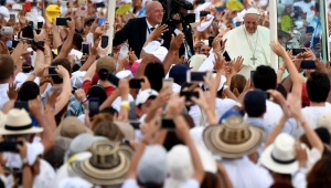 "Pope Francis waves from the Popemobile upon arrival at Contecar -Cartagena's maritime terminal- to celebrate an open-air mass during the last day of his visit to Colombia on September 10, 2017. Pope Francis prayed Sunday for a peaceful end to Venezuela's ""grave crisis"" which has left scores dead, as he wrapped up a tour to support peace in neighboring Colombia. / AFP PHOTO / Alberto PIZZOLI (Photo credit should read ALBERTO PIZZOLI/AFP/Getty Images)"