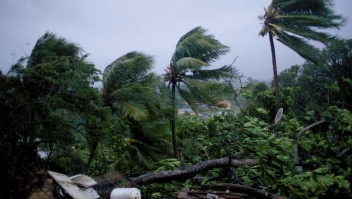 """TOPSHOT - A picture taken on September 19, 2017 shows the powerful winds and rains of hurricane Maria battering the city of Petit-Bourg on the French overseas Caribbean island of Guadeloupe. Hurricane Maria strengthened into a """"potentially catastrophic"""" Category Five storm as it barrelled into eastern Caribbean islands still reeling from Irma, forcing residents to evacuate in powerful winds and lashing rain. / AFP PHOTO / Cedrik-Isham Calvados (Photo credit should read CEDRIK-ISHAM CALVADOS/AFP/Getty Images)"""