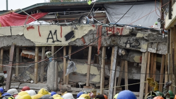 Rescue workers take part in the search for survivors and bodies at the Enrique Rebsamen elementary school in Mexico City on September 21, 2017, two days after a strong quake hit central Mexico. A powerful 7.1 earthquake shook Mexico City on Tuesday, causing panic among the megalopolis' 20 million inhabitants on the 32nd anniversary of a devastating 1985 quake. / AFP PHOTO / Alfredo ESTRELLA (Photo credit should read ALFREDO ESTRELLA/AFP/Getty Images)