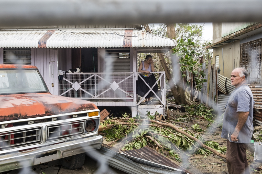 """SAN JUAN, PUERTO RICO - SEPTEMBER 21: Carlota Benitez, 77, and her husband Benjamin Benitez, at their home in the Guaynabo suburb after Hurricane Maria made landfall, September 21, 2017 in San Juan, Puerto Rico. The majority of the island has lost power, in San Juan many are left without running water or cell phone service, and the Governor said Maria is the """"most devastating storm to hit the island this century."""" (Photo by Alex Wroblewski/Getty Images)"""