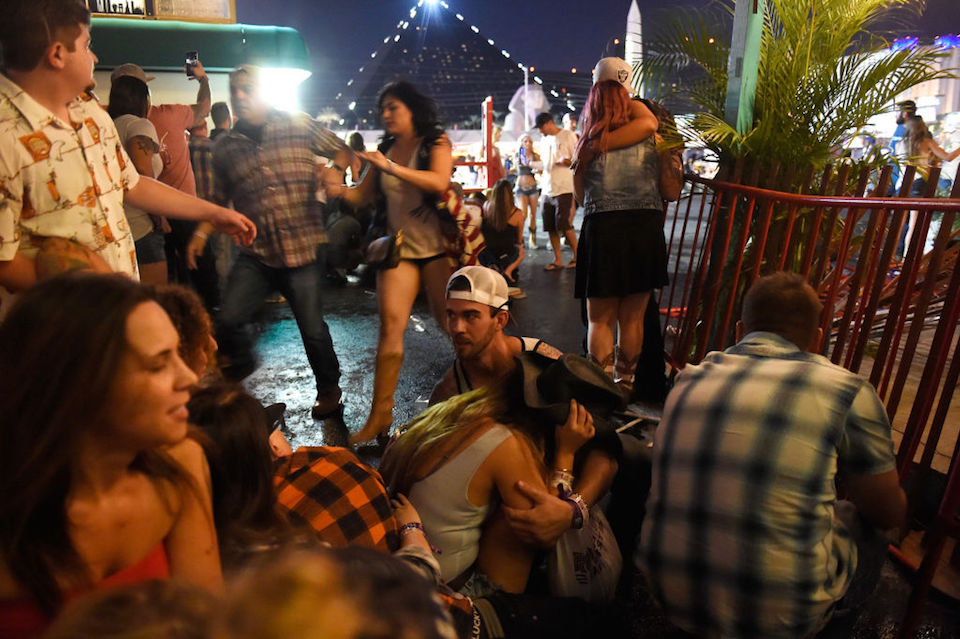 LAS VEGAS, NV - OCTOBER 01: People run for cover at the Route 91 Harvest country music festival after apparent gun fire was heard on October 1, 2017 in Las Vegas, Nevada. There are reports of an active shooter around the Mandalay Bay Resort and Casino. (Photo by David Becker/Getty Images)