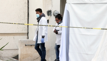 Forensic personnel work on a crime scene where attackers burst during a party and murdered 11 people in Tizayuca, Hidalgo state, Mexico, on July 13, 2017. Gunmen burst into a home in central Mexico during a party and killed 11 people, authorities and media reports said Thursday, the violence-plagued country's latest mass murder. Police found the gory scene when they responded to an emergency call received just after midnight in the city of Tizayuca, in the central state of Hidalgo, the state security service said in a statement. / AFP PHOTO / ALDO FALCON (Photo credit should read ALDO FALCON/AFP/Getty Images)