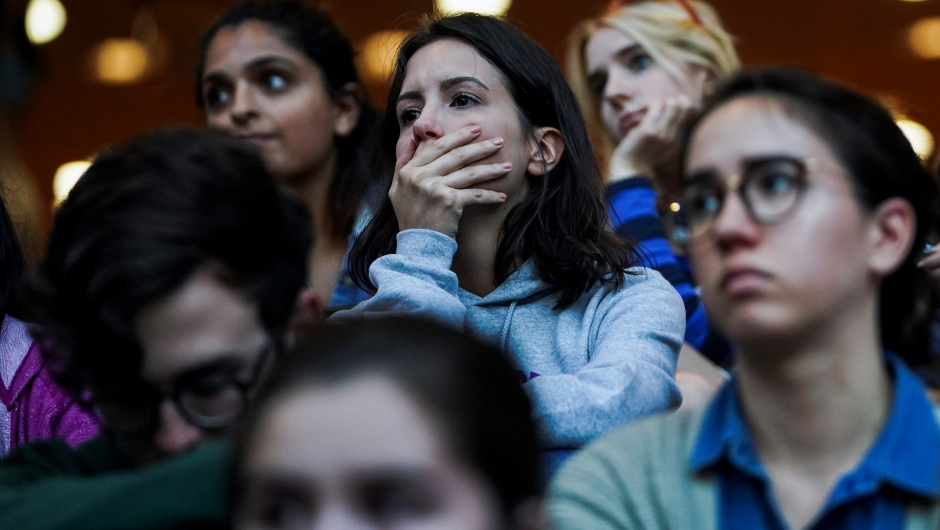 New York University (NYU) students attend a vigil for the victims of the mass shooting in Las Vegas, on October 2, 2017 in New York. The death toll from the deadliest mass shooting in US history rose to 58 on Monday as officials reacted cautiously to an Islamic State claim of responsibility for the massacre at a concert on the Las Vegas Strip. Police said Stephen Craig Paddock, 64, a wealthy former accountant, smashed windows in his 32nd floor hotel room Sunday night and trained bursts of automatic weapons fire on concert-goers below. / AFP PHOTO / Jewel SAMAD (Photo credit should read JEWEL SAMAD/AFP/Getty Images)