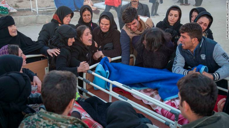 Iranians mourn over the body of a victim following a 7.3-magnitude earthquake in Sarpol-e Zahab in Iran's western province of Kermanshah on November 13, 2017. More than 200 people were killed and hundreds more injured when the 7.3-magnitude earthquake shook the mountainous Iran-Iraq border triggering landslides that hindered rescue efforts, officials said. / AFP PHOTO / TASNIM NEWS / Farzad MENATI (Photo credit should read FARZAD MENATI/AFP/Getty Images)