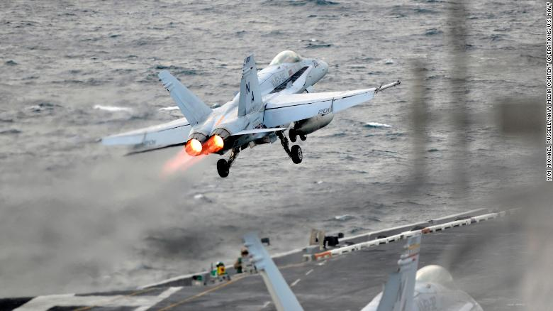 71111-N-KB563-1237 WESTERN PACIFIC (Nov. 11, 2017) An F/A-18E Super Hornet, assigned to the Stingers of Strike Fighter Attack Squadron (VFA) 113, launches from the flight deck of the aircraft carrier USS Theodore Roosevelt (CVN 71) in the western Pacific Ocean. Aircraft carriers, Theodore Roosevelt, Ronald Reagan, and Nimitz strike groups are underway conducting flight operations in international waters as part of a three-carrier strike force exercise. The U.S. Pacific Fleet has patrolled the Indo-Pacific region routinely for more than 70 years promoting regional security, stability and prosperity. (U.S. Navy photo by Mass Communication Specialist 1st Class Michael Russell/Released)