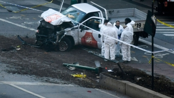 "TOPSHOT - Investigators inspect a truck following a shooting incident in New York on October 31, 2017. Several people were killed and numerous others injured in New York on Tuesday after a vehicle plowed into a pedestrian and bike path in Lower Manhattan, police said. ""The vehicle struck multiple people on the path,"" police tweeted. ""The vehicle continued south striking another vehicle. The suspect exited the vehicle displaying imitation firearms & was shot by NYPD."" / AFP PHOTO / DON EMMERT (Photo credit should read DON EMMERT/AFP/Getty Images)"